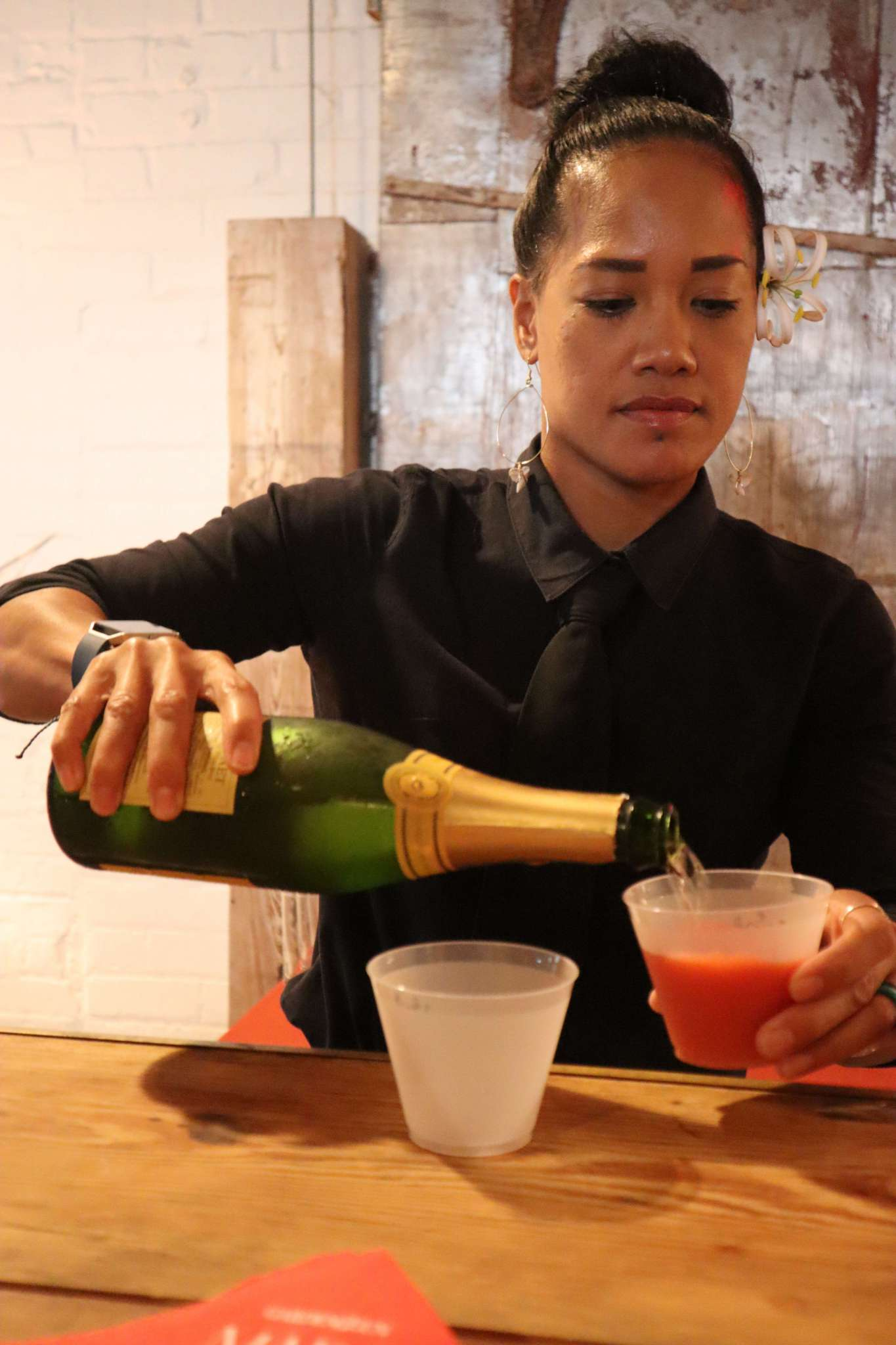 A woman mixing drinks