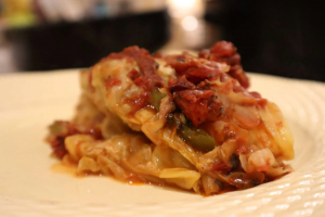 finishes baked stuffed cabbage roll on a plate