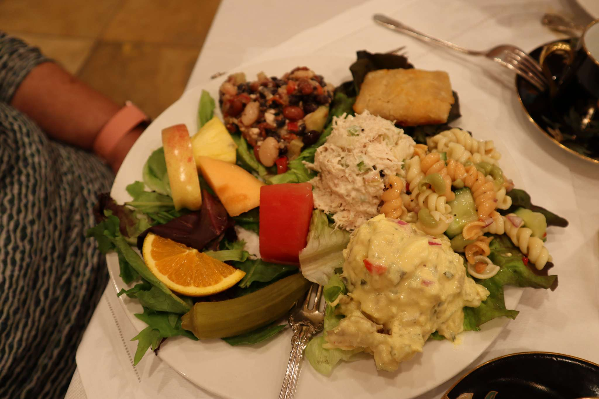 A plate of food on a table, with Cottage Tea Room