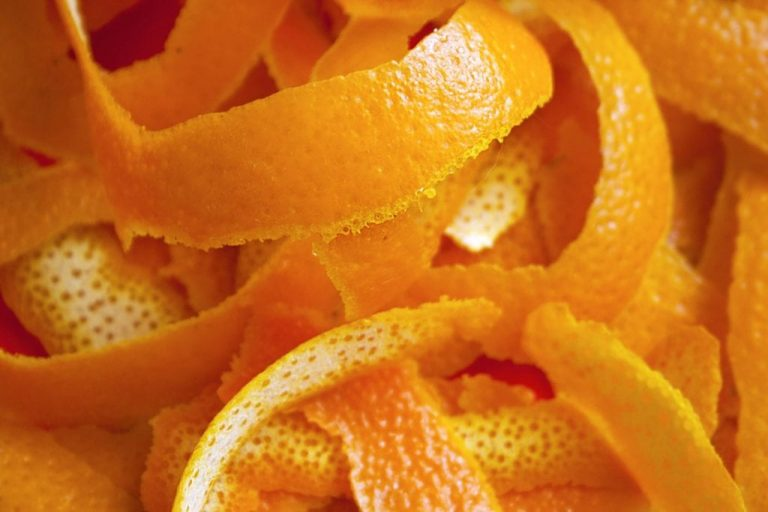 A close up of a pile of oranges