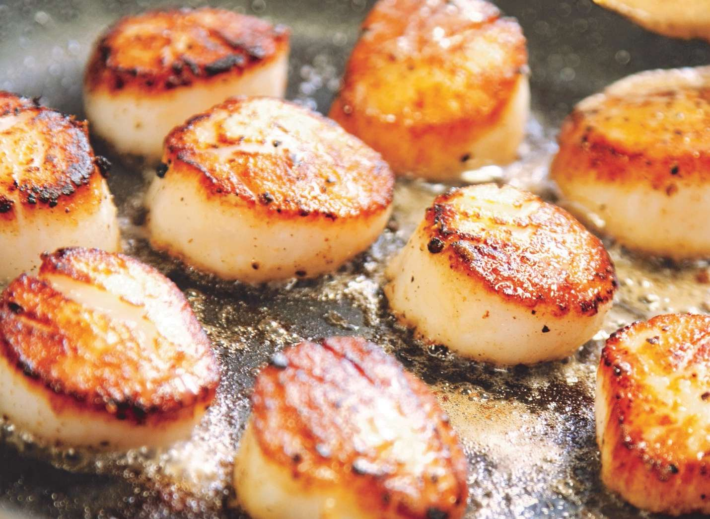 A close up of food, with Butter and Scallop
