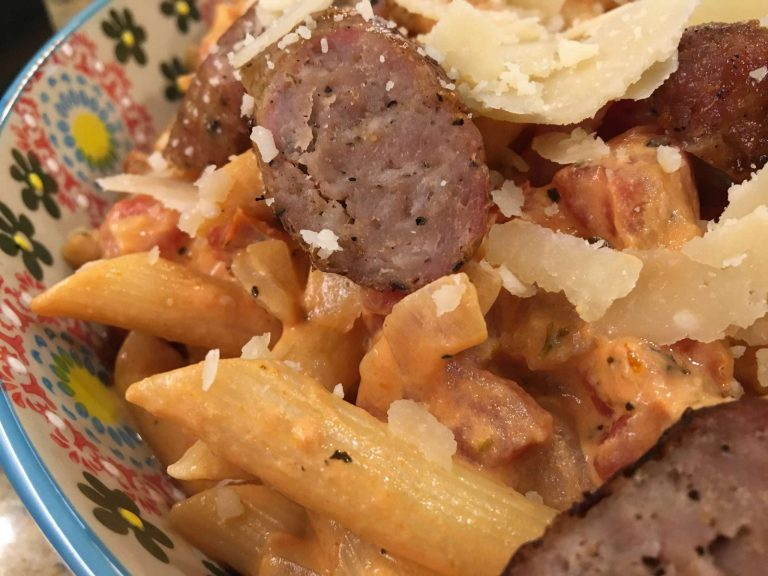 A close up of a plate of food, with Penne