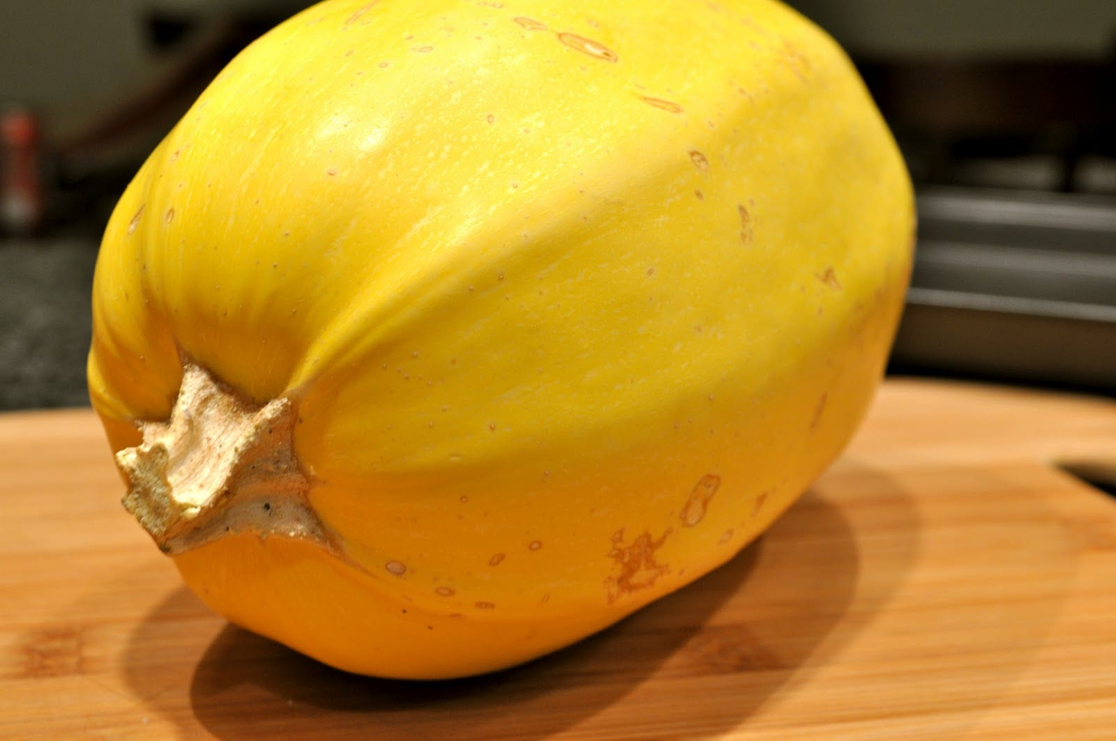 A squash sitting on top of a wooden table