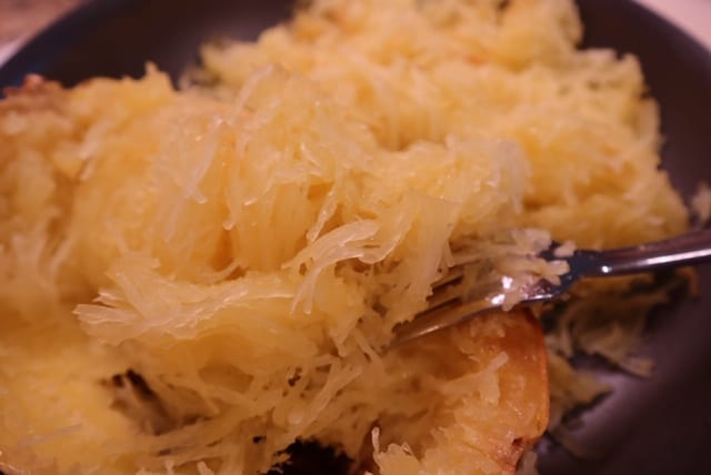A close up of a plate of food with rice, with Spaghetti squash