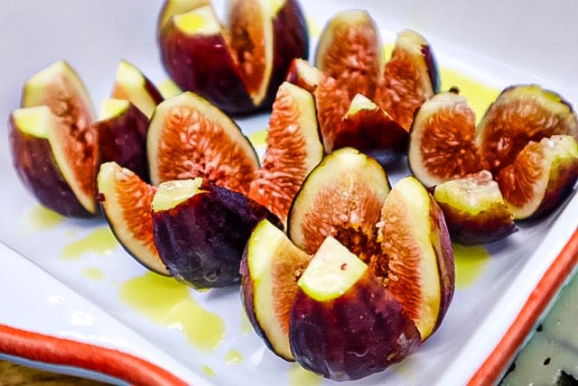 seasonal treat roasted figs with roquefort and honey picture of fresh figs with cross cut in them Gunters honey and Thea olive oil drizzled