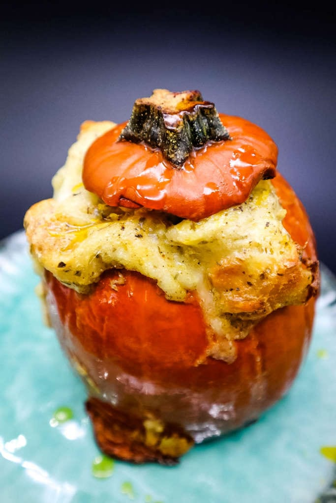 a baked sugar pumpkin, with stuffing and cheese
