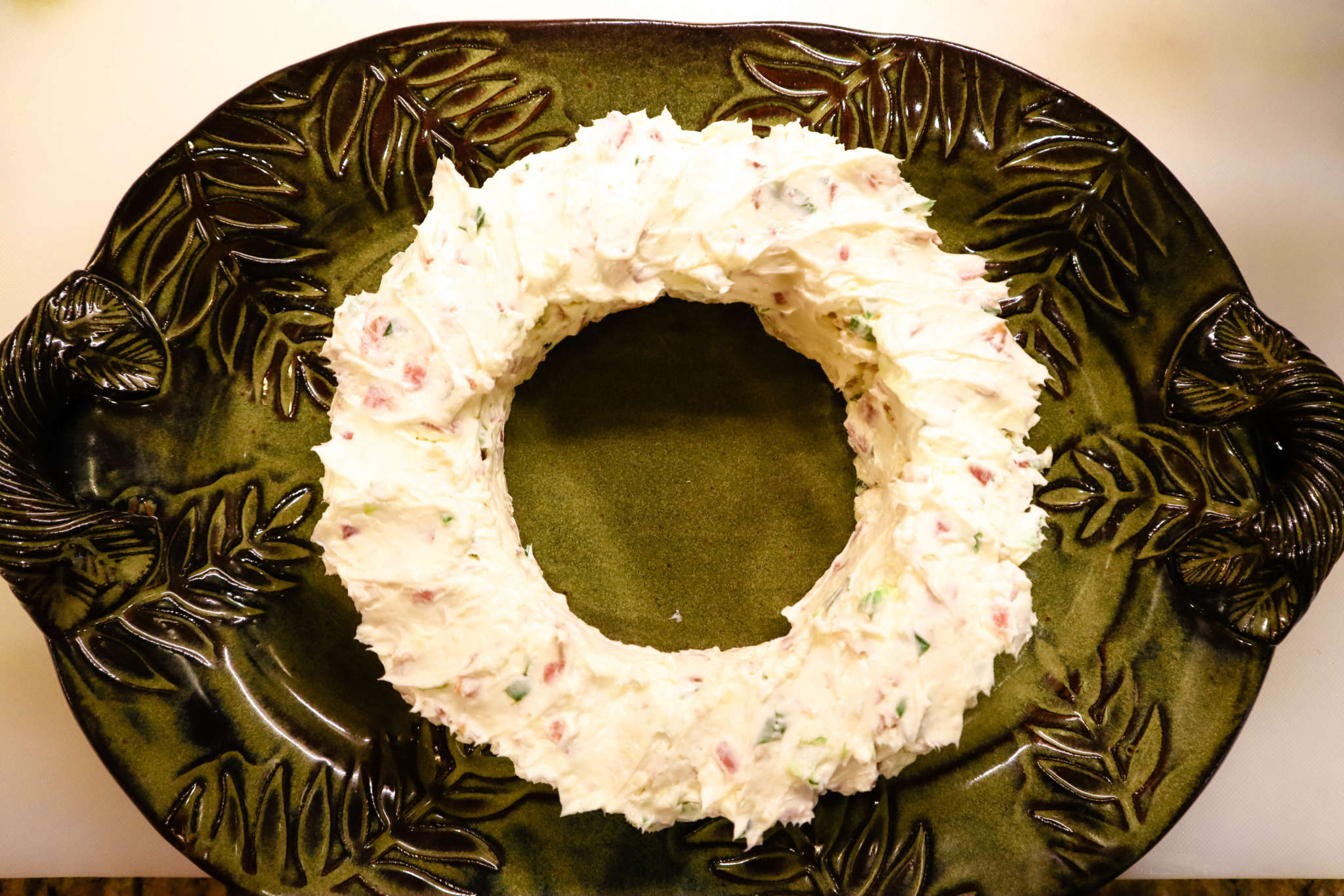 A close up of a Bacon and Cheese dip in shape of Wreath