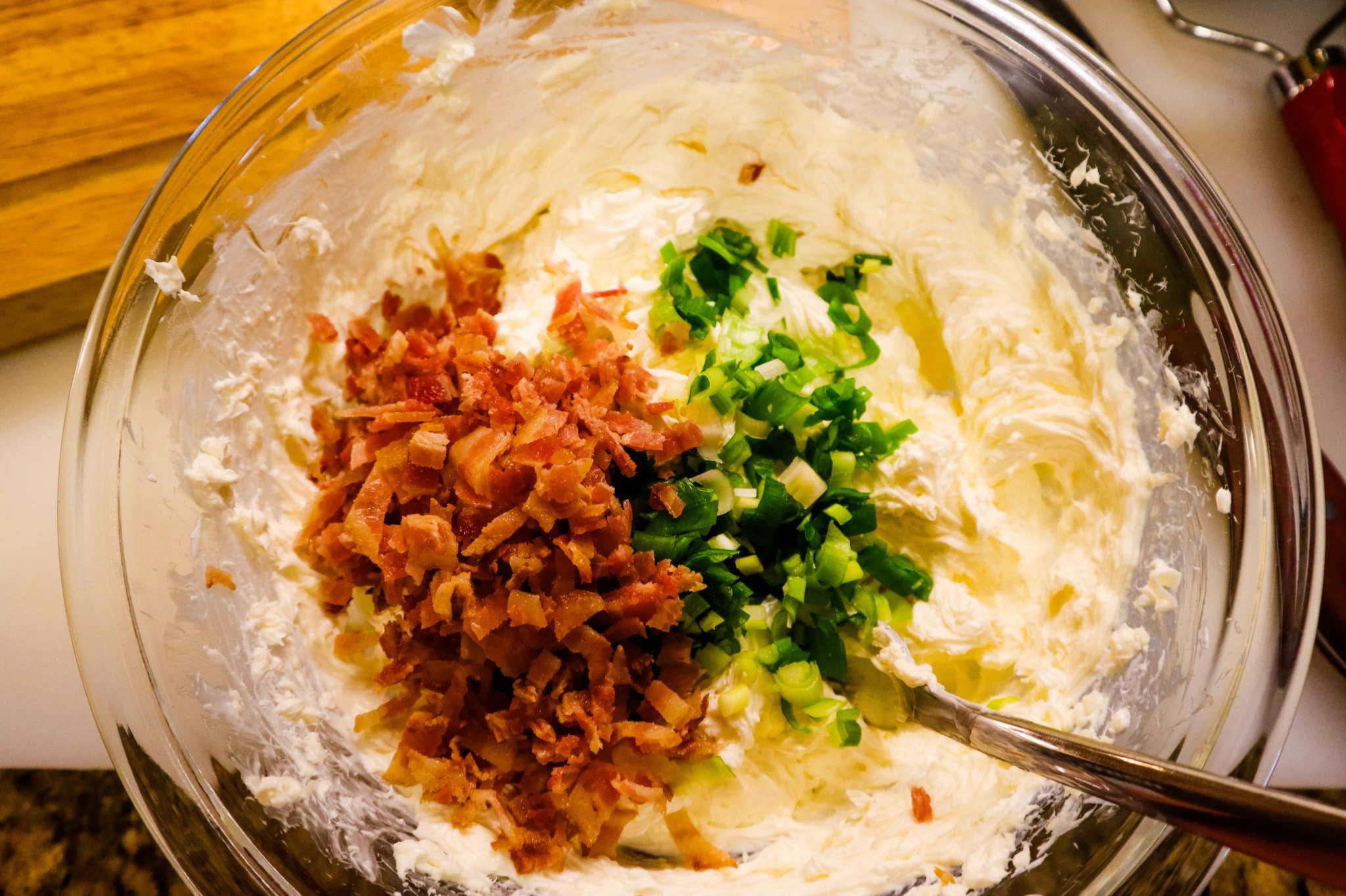A plate of food with rice, with Cheese and Bacon
