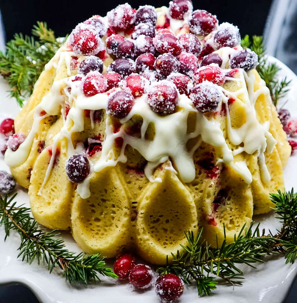 a bundt cake with sugared fruit