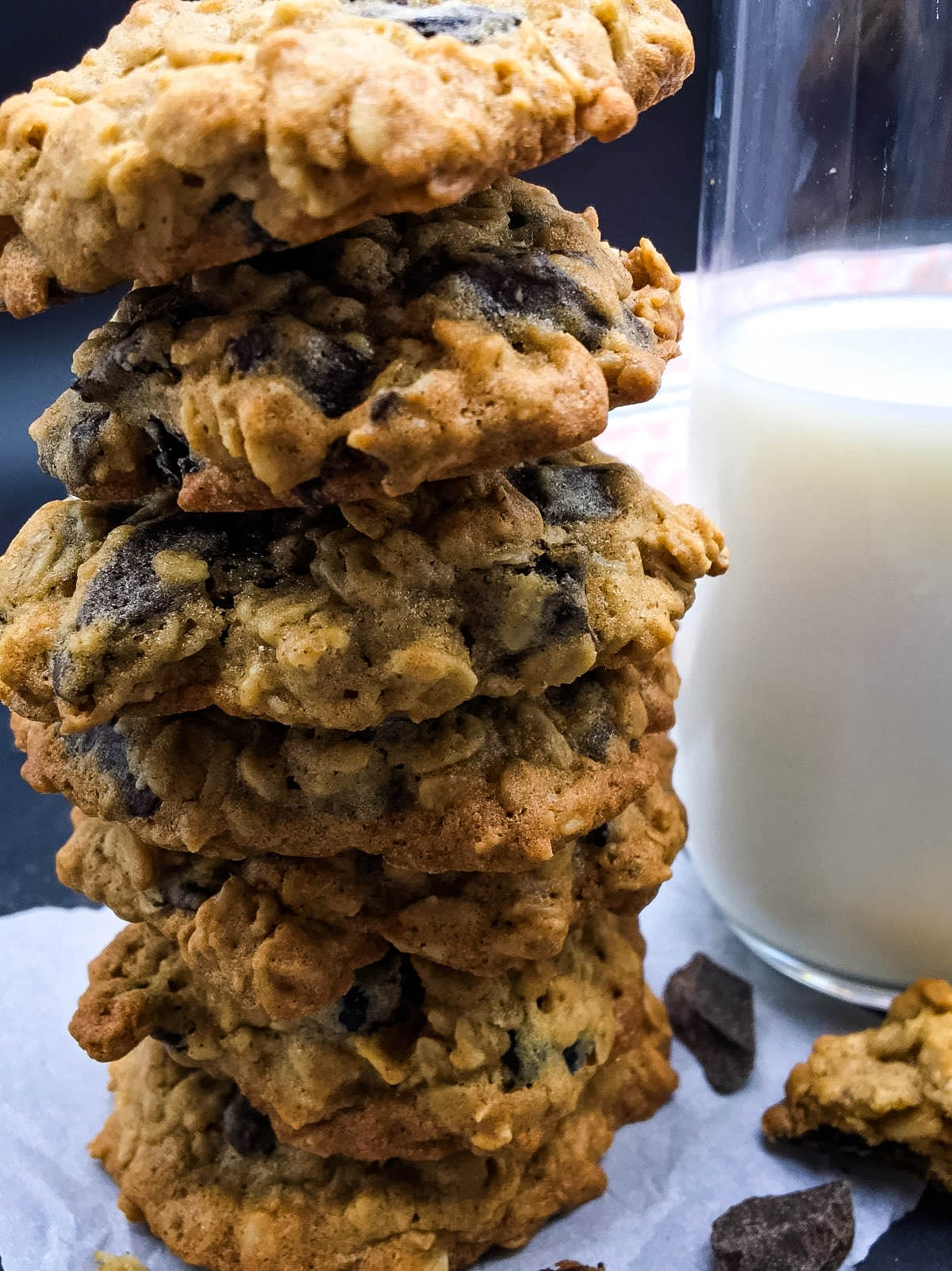 stack of cherry chocolate chunk oatmeal cookies and a glass of milk
