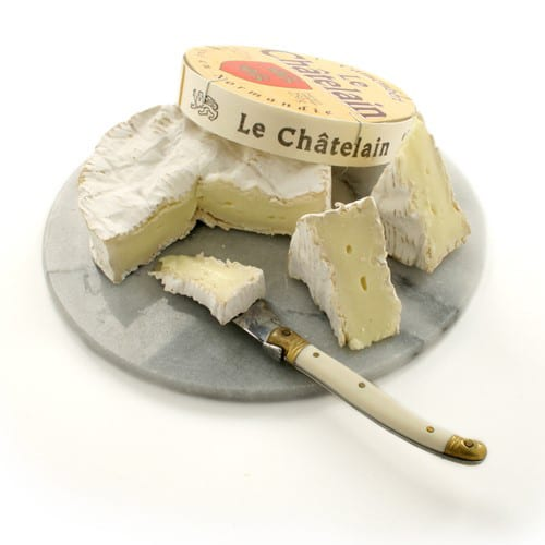 wheel of Brie cheese on a plate
