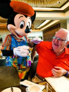 my Dad with Micky Mouse at Topolino's Restaurant Disney