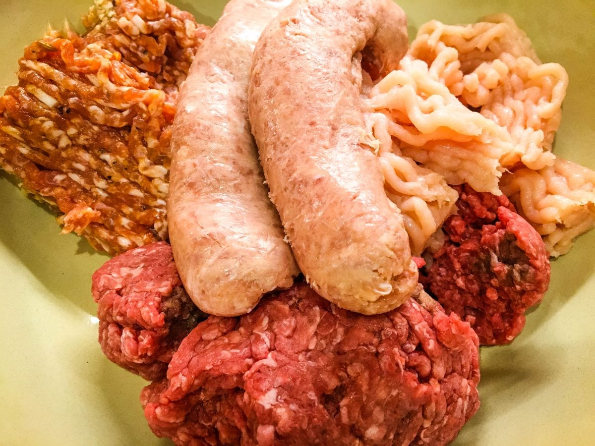 A close up of food, with Beef and Sausage
