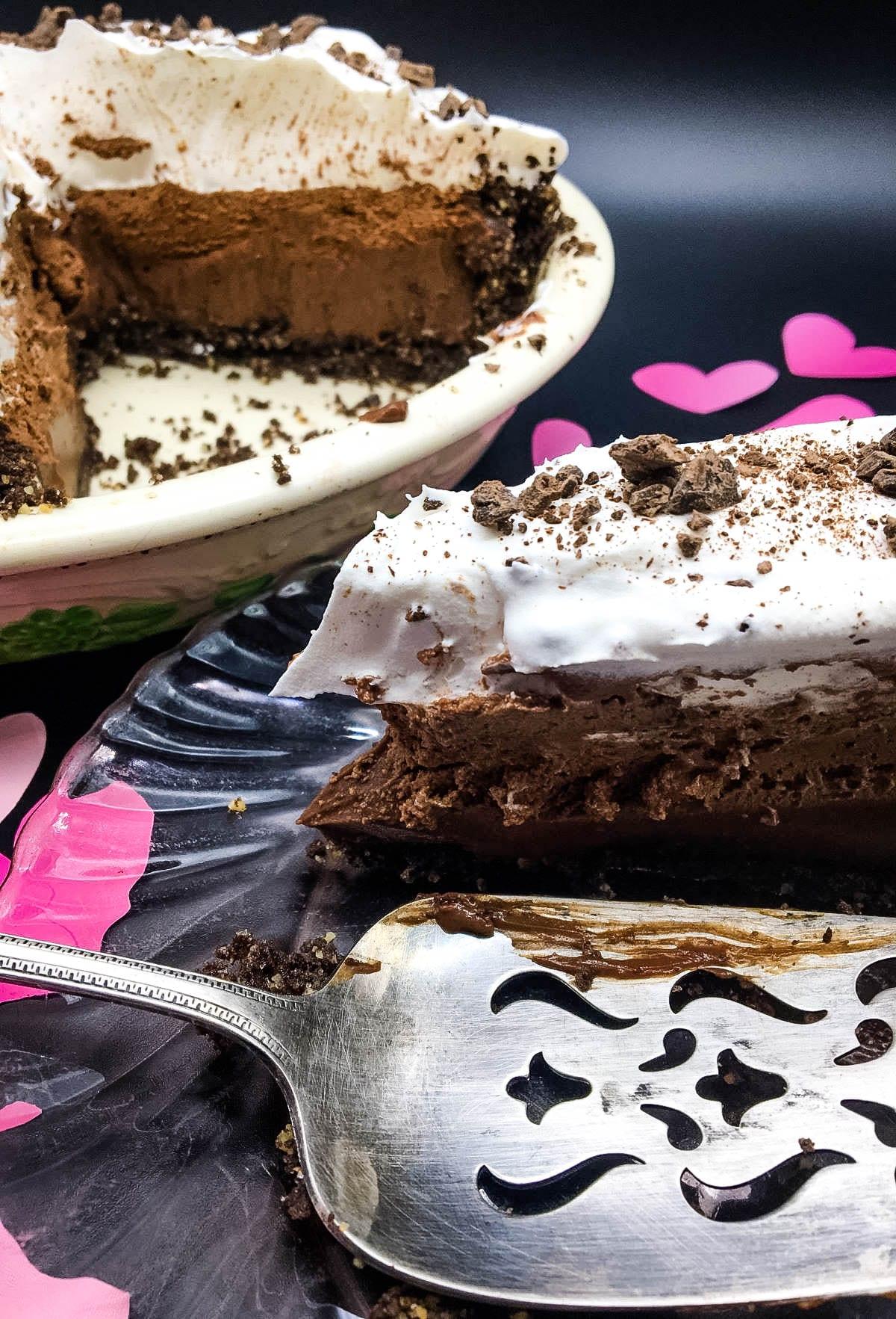 slice of chocolate pie on plate next to whole pie
