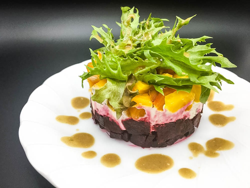 A salad of beets and cheese on a plate, with Salad and Vinaigrette