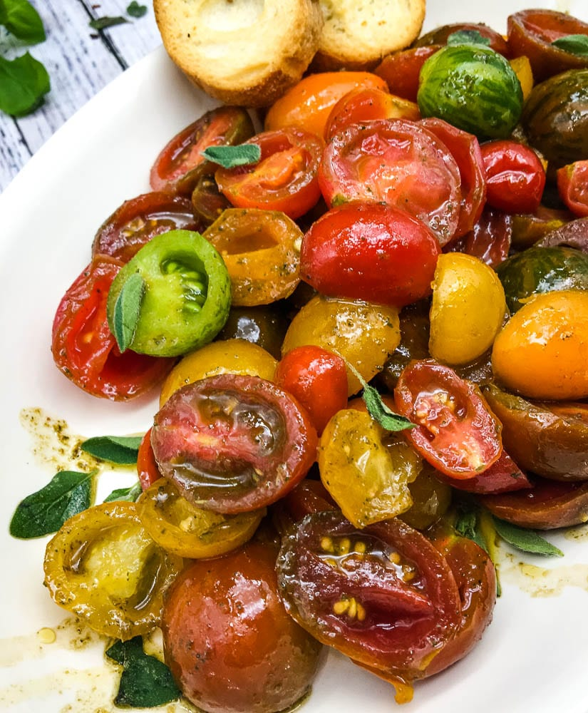 A plate of food, with Salad and Tomato