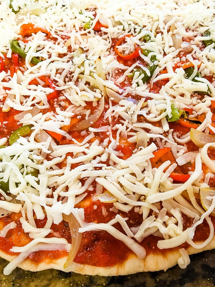 A pizza covered in cheese and toppings