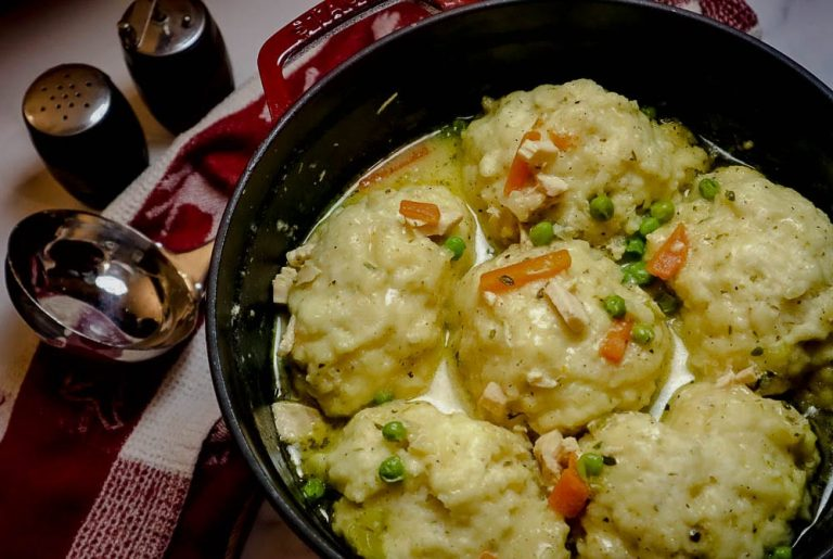 A plate of food with rice meat and vegetables, with Chicken and Dumpling