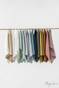 linen kitchen towels hanging in a line