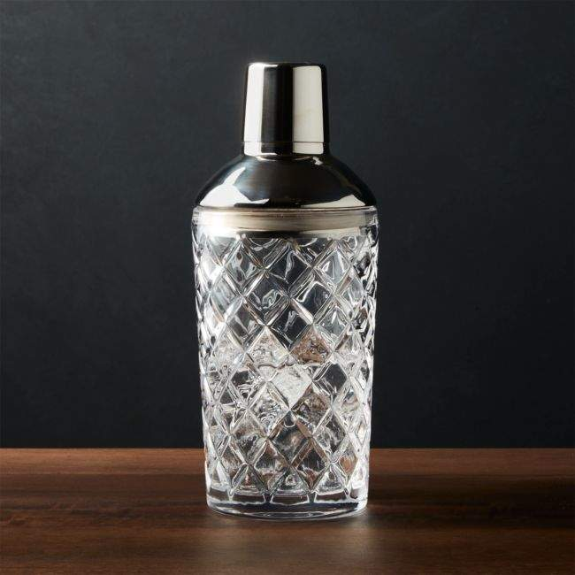 A tall cocktail shaker on a table