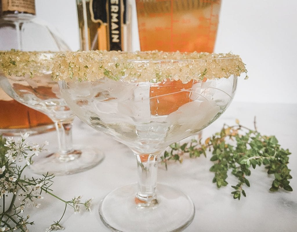 A rimmed glass, with Apricot and Fizz