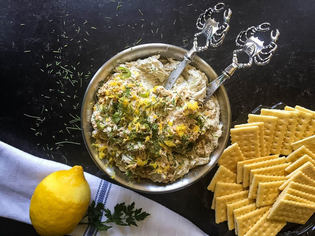 A bowl of food, with Crab dip
