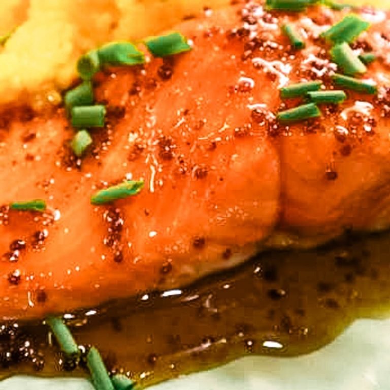 A close up of a plate of food with salmon