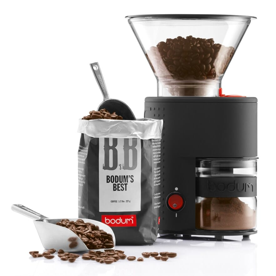 coffe grinder next to bag of coffee beans