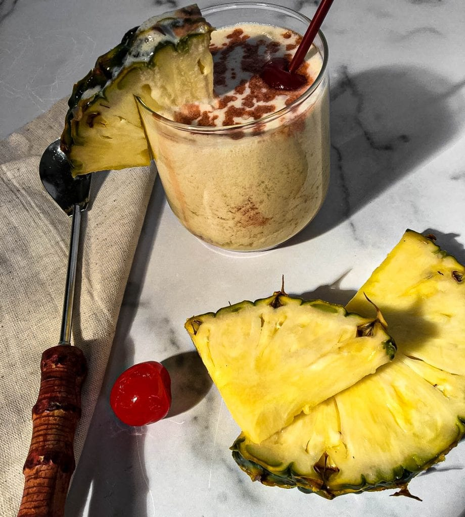 A plate of food on a table, with Coconut and Pineapple