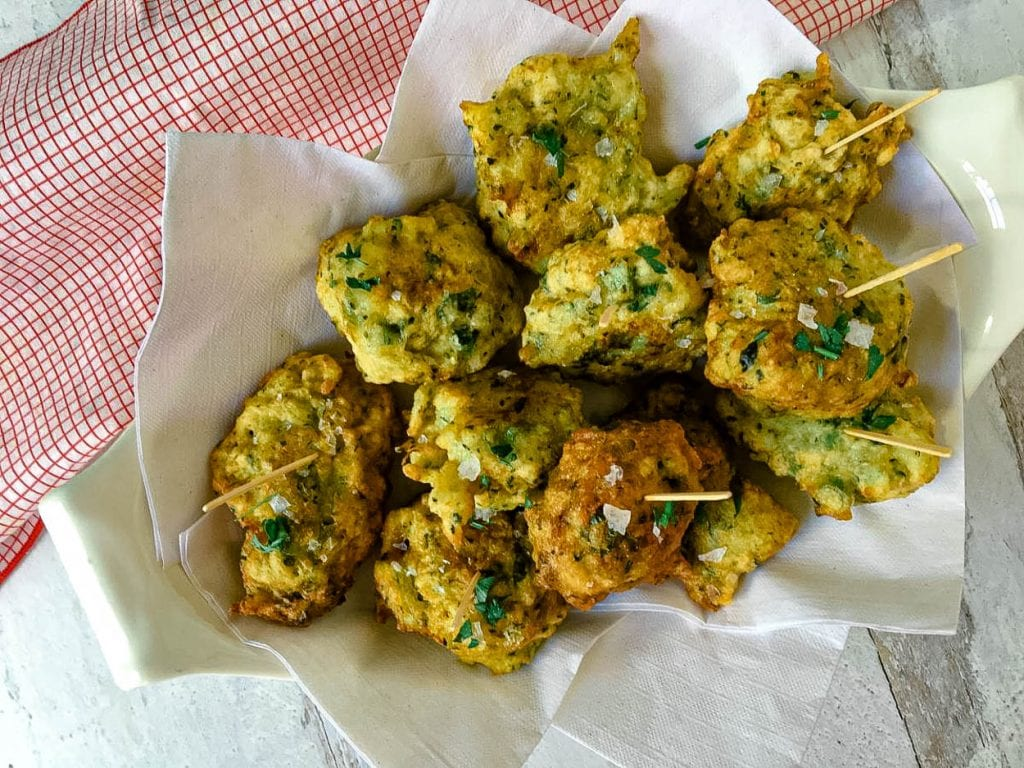 Food on a table, with Fritter and Croquette