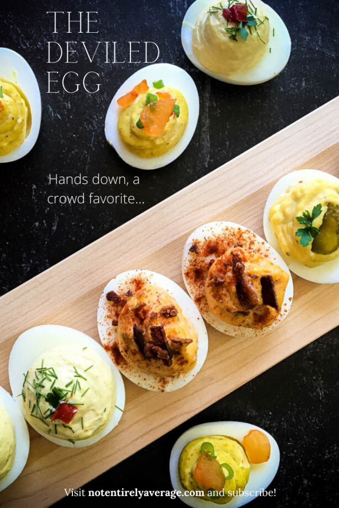 A bunch of food sitting on a table, with Deviled egg