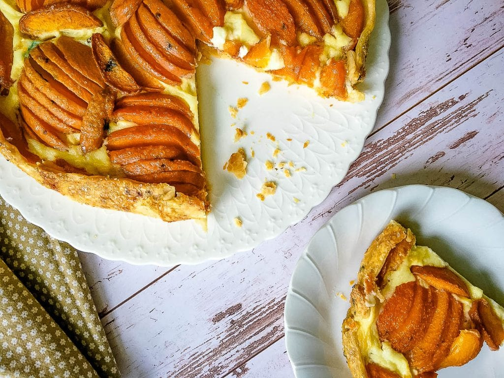 A piece of pastry on a plate, with Crostata and Cheese