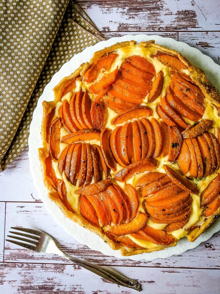 apricot crostata and fork on wood surface