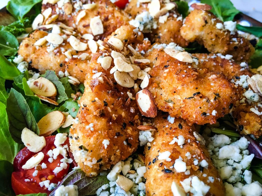 A close up of a plate of food with, Salad and Chicken