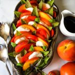 A close up of food, with Peach and and tomato