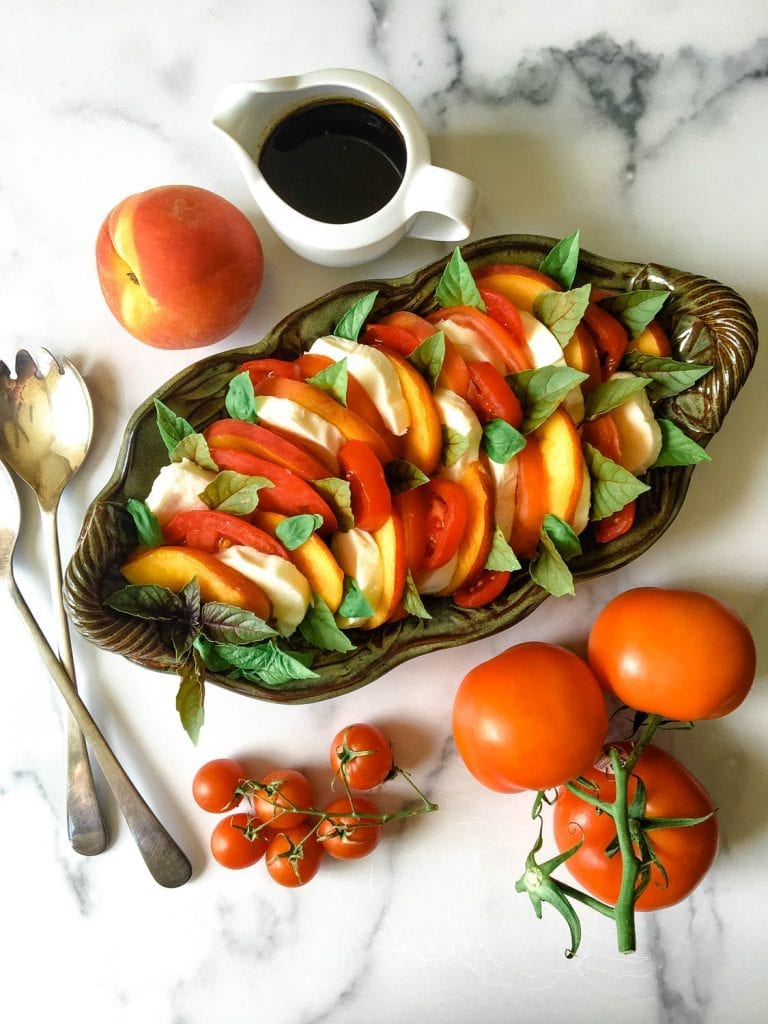 Food on a table, with Tomato and Caprese salad