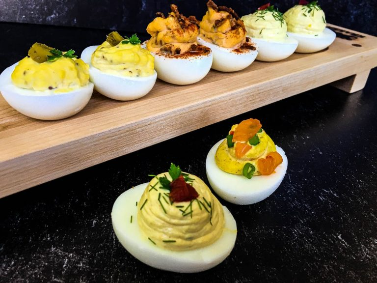 A wooden board, with deviled eggs