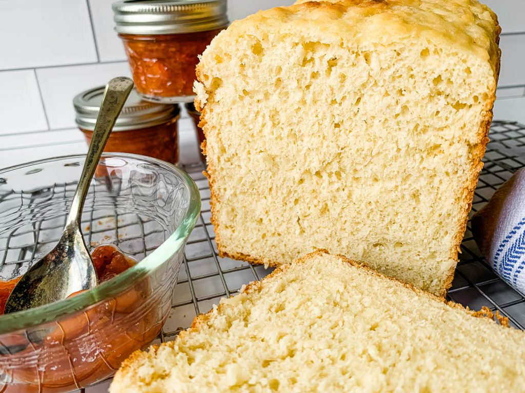 A loaf of bread on a table, with jelly