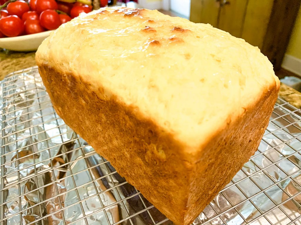 A loaf of bread sitting on top of a cooling rack