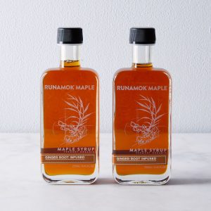 A close up of two bottles of syrup
