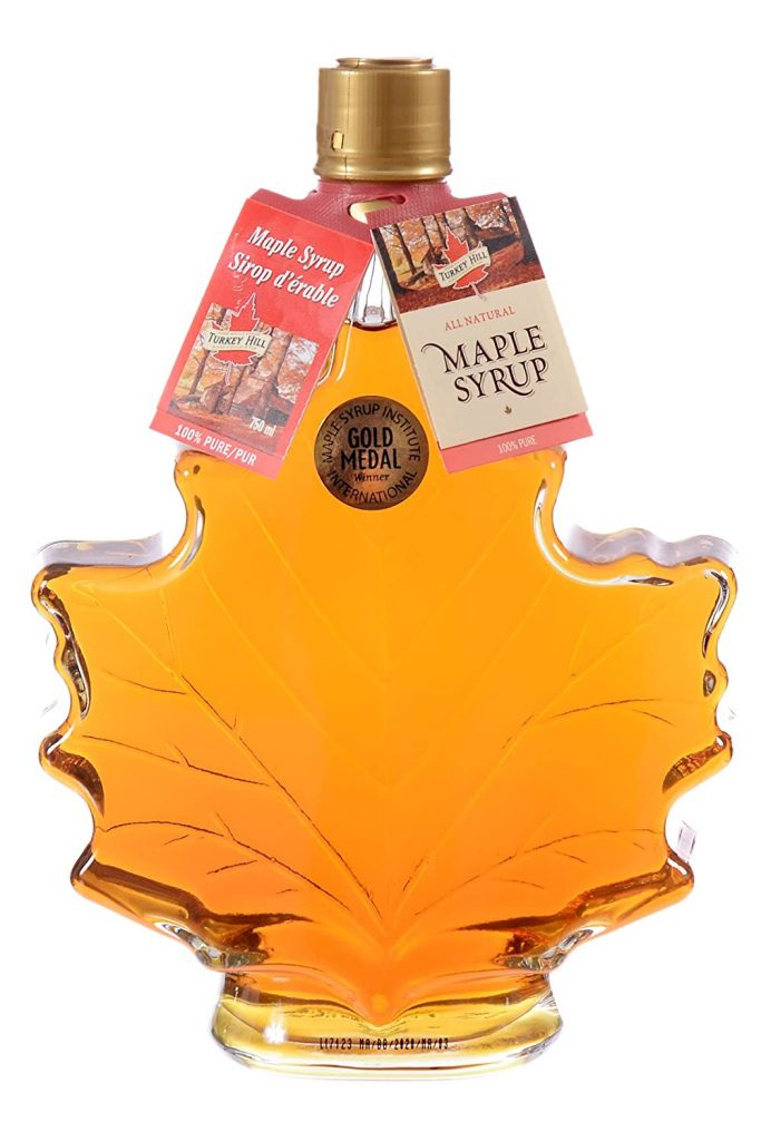 bottle of maple syrup in a bottle shaped like a leaf