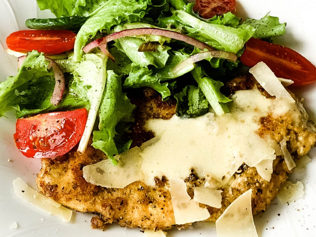 chicken cutlet with salad on top