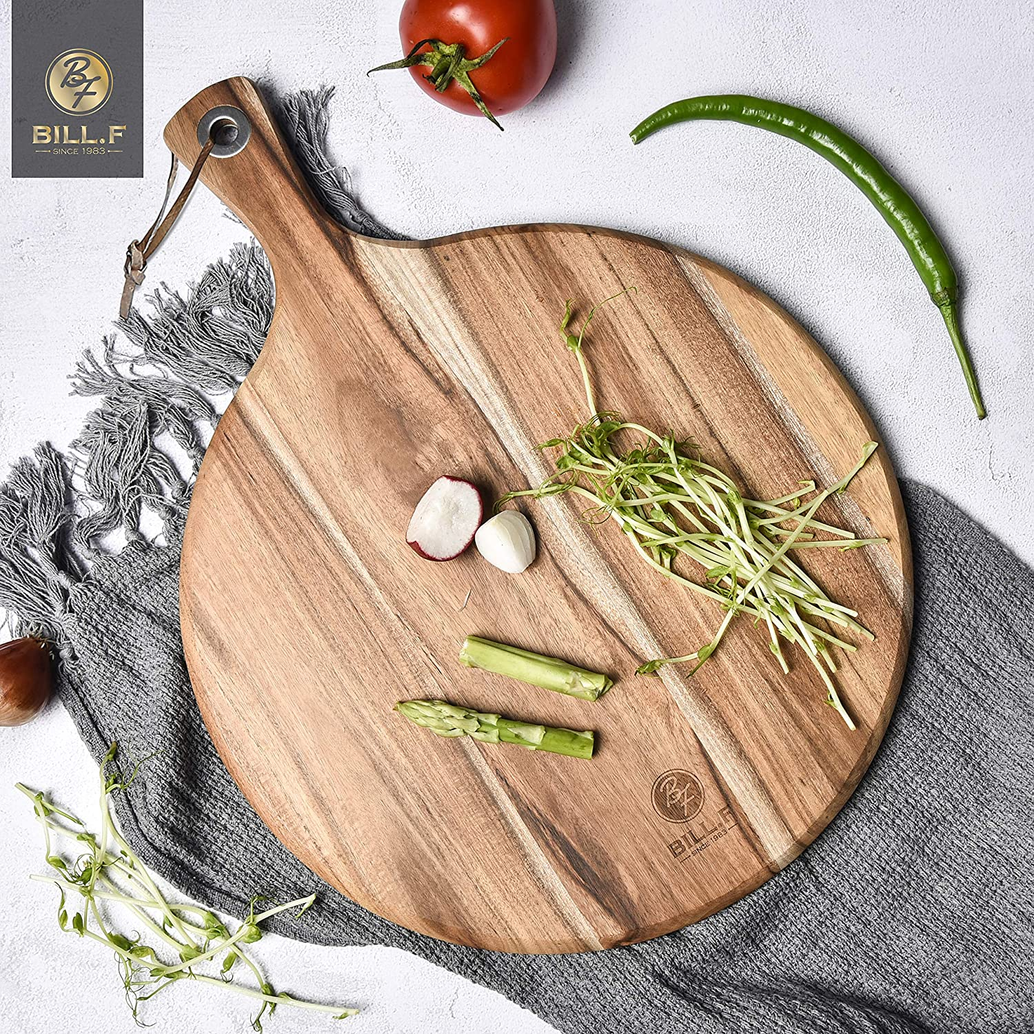 round wooden pizza peel or bread board