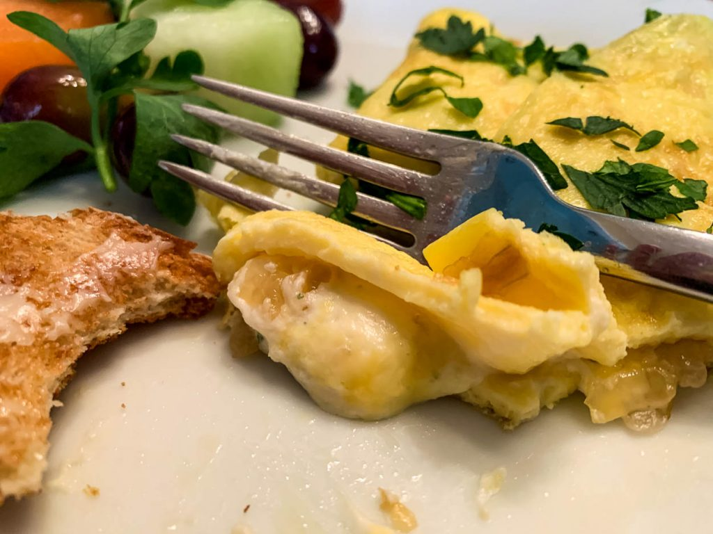 fork cutting into a bite of Boursin Omelet
