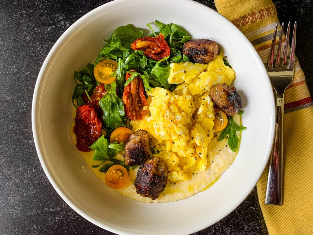 white bowl with scrambled eggs, with salad