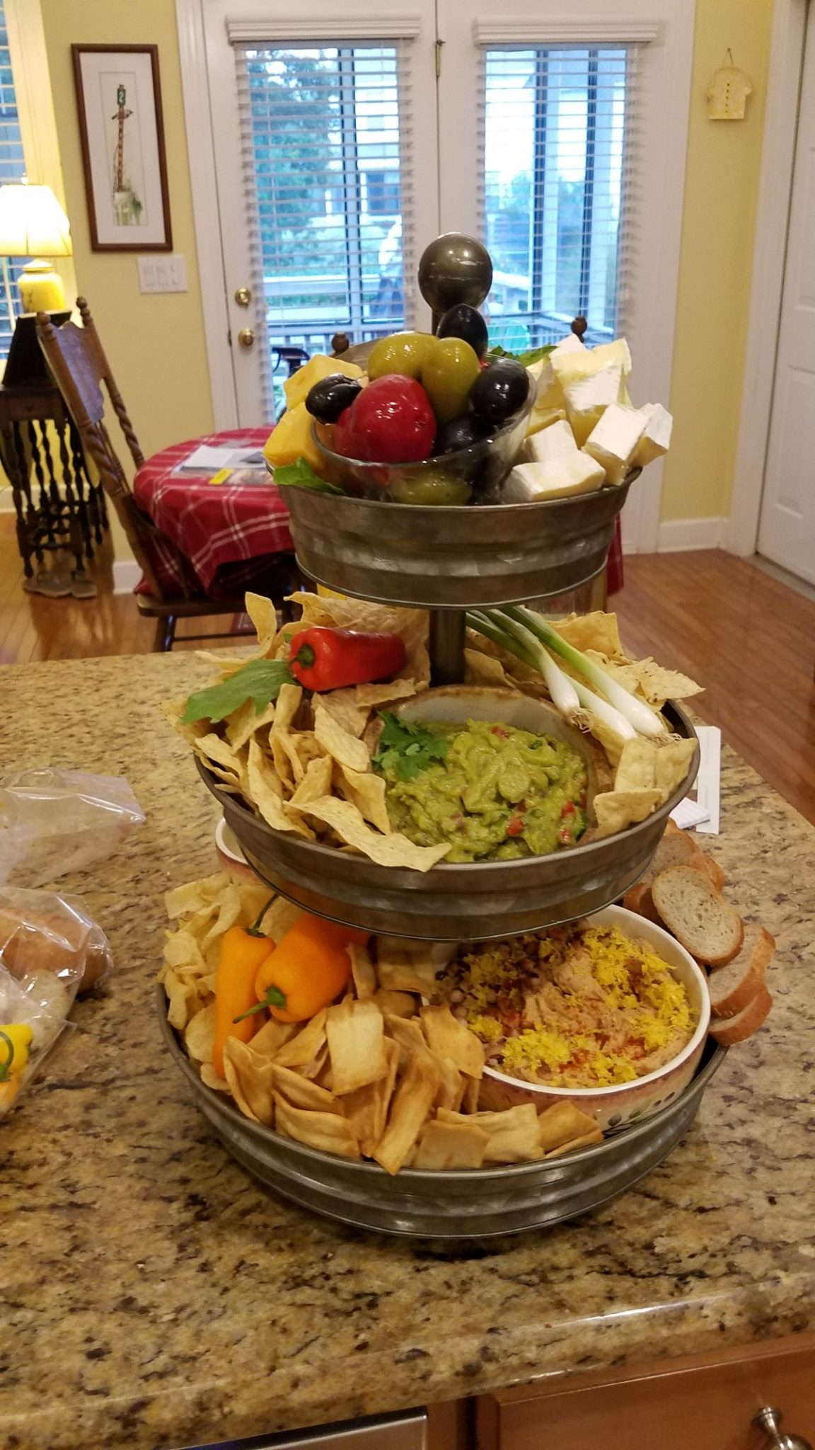 assembling a snack tray with 3 tiers