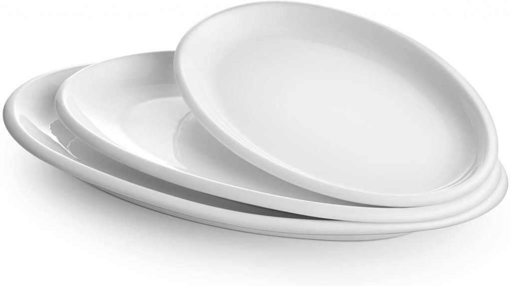 A bowl sitting on a plate, with Platter