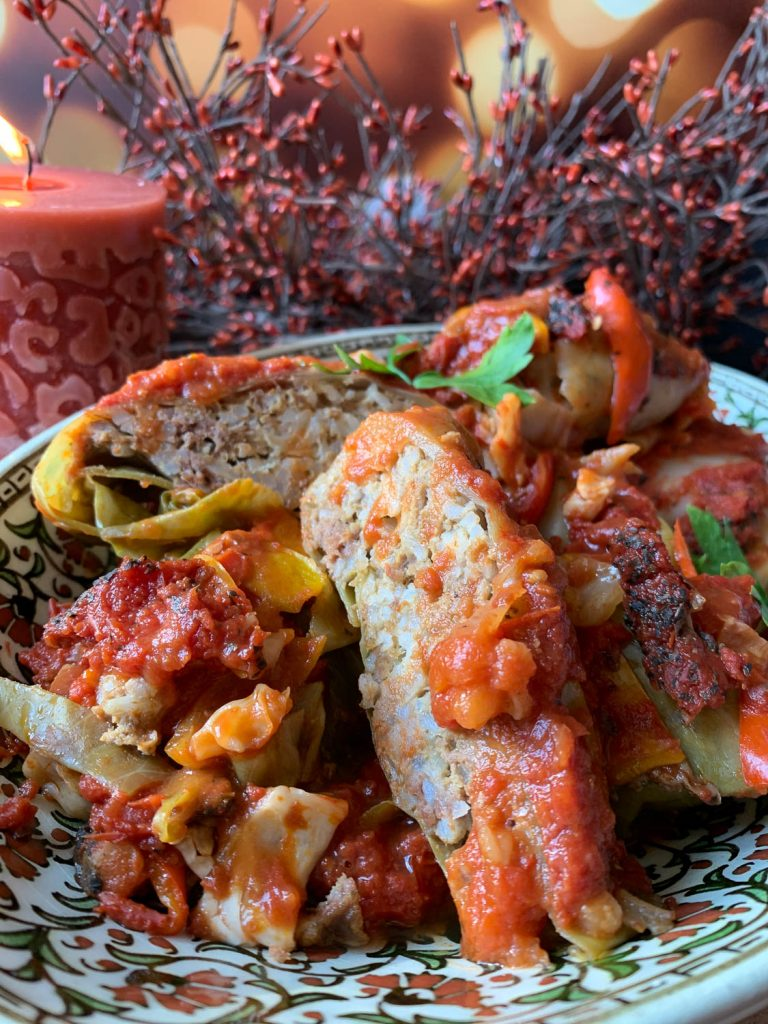 A plate of food, with Cabbage roll and Chicken