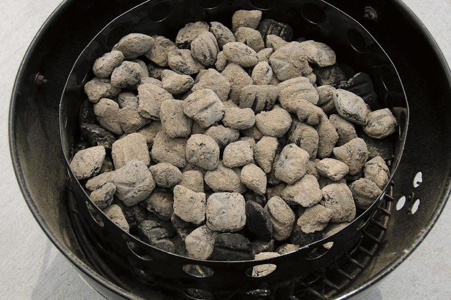 hot coals in a water smoker