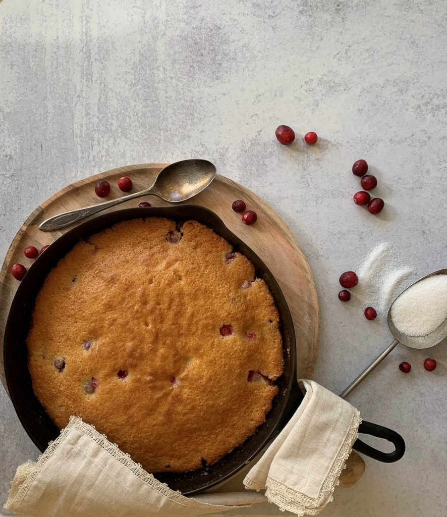 overhead photo of cake in a cast iron skillet